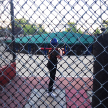 Alicia in the batting cages